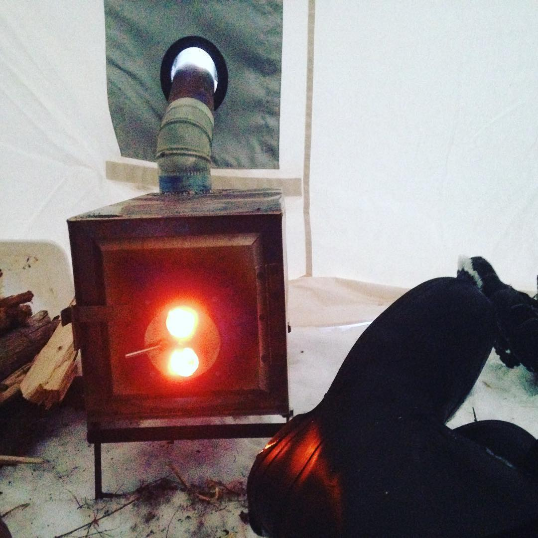 enjoying-the-warmth-of-the-expedition-tent-and-stove-at-the-end-of-a-long-day_24542585126_o